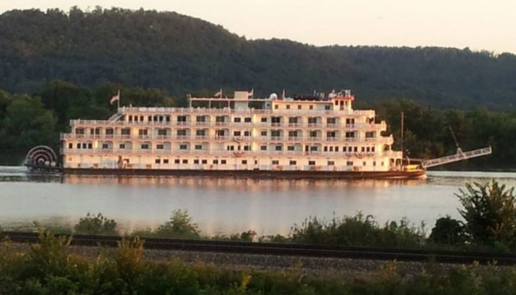 A river boat cruises by on the Misissippi River boat in front of Sullivan's Supper Club in Trempealeau, WI